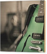 Green Electric Guitar With Blurry Background Wood Print