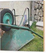 Green Wheelbarrow Lying On A Green Meadow Wood Print
