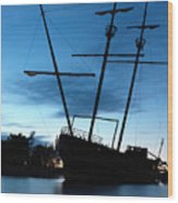 Grounded Tall Ship Silhouette Wood Print by Oleksiy Maksymenko