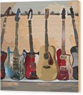 Guitars On A Rack Wood Print