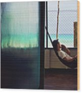Guy With The Hat Lying In A Hammock On The Porch Of The Old House And Relaxing By The Caribbean Sea Wood Print