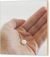 Hand Holding Medicinal Tablet Wood Print by Blink Images