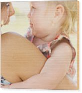 Happy Mother Holding Baby With Look Of Surprise Wood Print