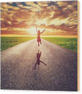Happy Woman Jumping On Long Straight Road Wood Print