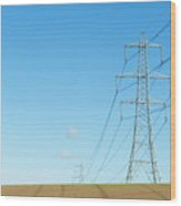 Hardly A Cloud In The Sky As Pylons Distribute Energy Through The Region. Wood Print