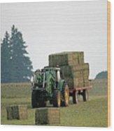 Hauling Hay At Dusk Wood Print