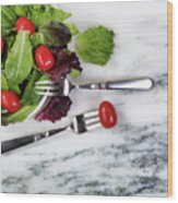 Healthy Organic Salad Flowing Out Of Plate On Natural Marble Tab Wood Print