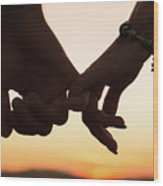 Holding hands in the sunset Wood Print