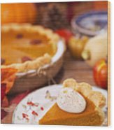 Homemade Pumpkin Pie On A Rustic Table With Autumn Decorations Wood Print