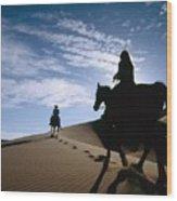 Horseback Riders In Silhouette On Sand Wood Print