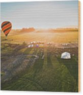 Hot Air Balloon Taking Off At Sunrise Wood Print