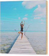 Hot Girl In White Jeans Doing Yoga On The Wooden Pier By The Sea Wood Print
