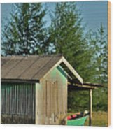 Hut With Green Boat Wood Print