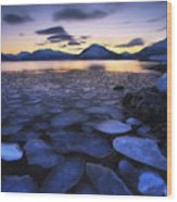 Ice Flakes Drifting Against The Sunset Wood Print by Arild Heitmann