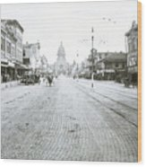 In This Historical 1913 Photo, Horse Drawn Carriages In Downtown Austin, Texas Run Up And Down Congress Avenue Cobblestone Streets Leading Up The The Texas State Capitol Wood Print