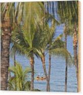 Kayakers Through Palms Wood Print