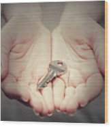 Key In Woman's Hand In Gesture Of Giving. Concept Of Success In Live, Business Solution, Real Estate Etc Wood Print