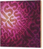 Kiss Kiss Words On Pink Wood Print by Michael Tompsett