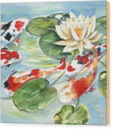 Koi In The Water Lilies Wood Print
