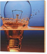 Light Bulb And Splash Water Wood Print by Setsiri Silapasuwanchai