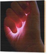 Light Captured In Child's Hand Wood Print