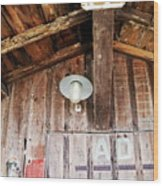 Light Hanging Inside An Old Wooden Hut Wood Print