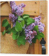 Lilacs In A Straw Purse Wood Print