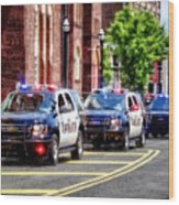 Line Of Police Cars Wood Print