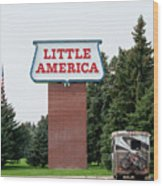 Little America Hotel Signage Vertical Wood Print