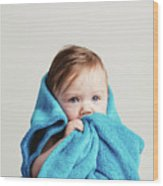 Little Baby Girl Tucked In A Cozy Blue Blanket. Wood Print