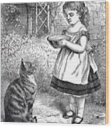 Little Girl Gives Her Cat Its Dinner Wood Print