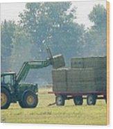 Loading Hay At Dusk Wood Print