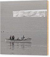Lone Giant Iceberg And Small Sea Boat Wood Print