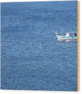 Lonely Fishing Boat Sailing On A Calm Blue Sea Wood Print