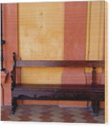 Long Wooden Bench Against A Yellow Wall At The Alcazar Of Seville Wood Print