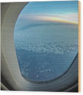 Looking Out Of Airplane Window During Flight Wood Print