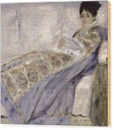Madame Monet On A Sofa Wood Print by Pierre Auguste Renoir