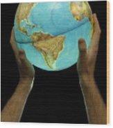 Man Holding Illuminated Earth Globe Wood Print