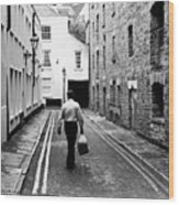 Man Walking With Shopping Bag Down Narrow English Street Wood Print