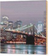 Manhattan And Brooklyn Bridge Under Fog. Wood Print by Shobeir Ansari