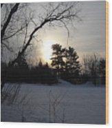 March Sunrise Behind Pines Wood Print