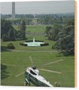 Marine One Lifts Off From The South Wood Print by Everett