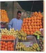 Market Vendor Selling Fruit In A Bazaar Wood Print