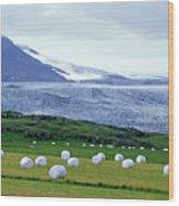 Meadow With Hay Bales And Glaciers Near Jokulsarlon Lagoon In Iceland Wood Print