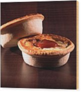 Meat Pies With Sauce And High Contrast Lighting. Wood Print