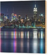 Midtown Manhattan From Jersey City At Night Wood Print by Val Black Russian Tourchin