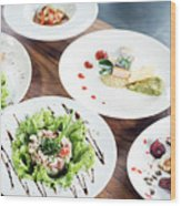 Mixed Modern Gourmet Fusion Food Dishes On Table Wood Print