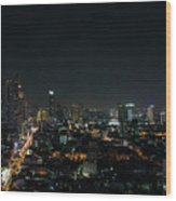 Modern Buildings In Silom Area Of Bangkok Thailand At Night Wood Print