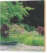 Monet's Garden Pond And Boat Wood Print