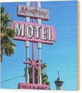 Monterey Motel Sign And The Stratosphere Wood Print